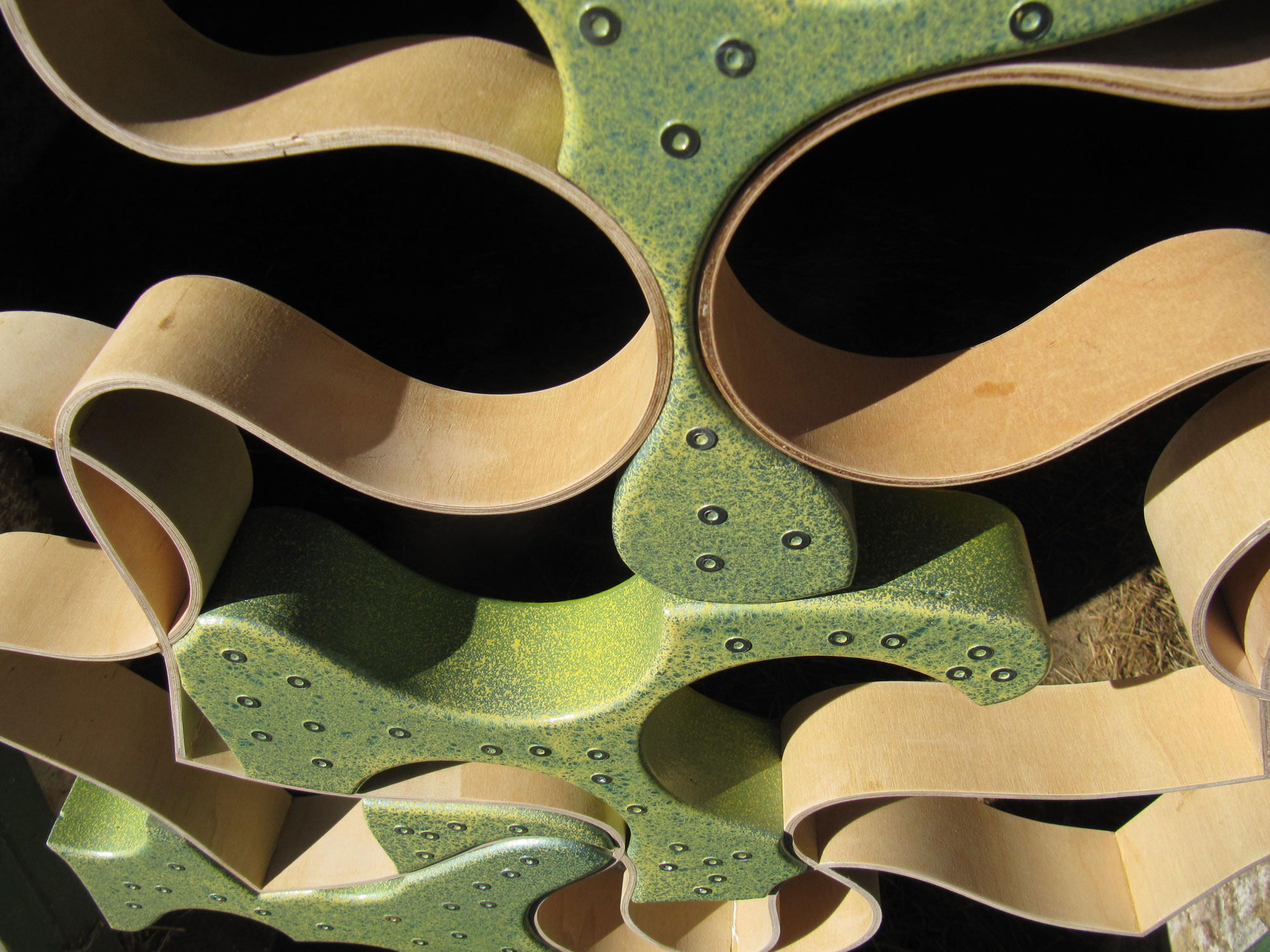 detail of wood and bronze sculpture 'Memories alarmed by the spectre of Alzheimers' with grass-green and lime yellow patina