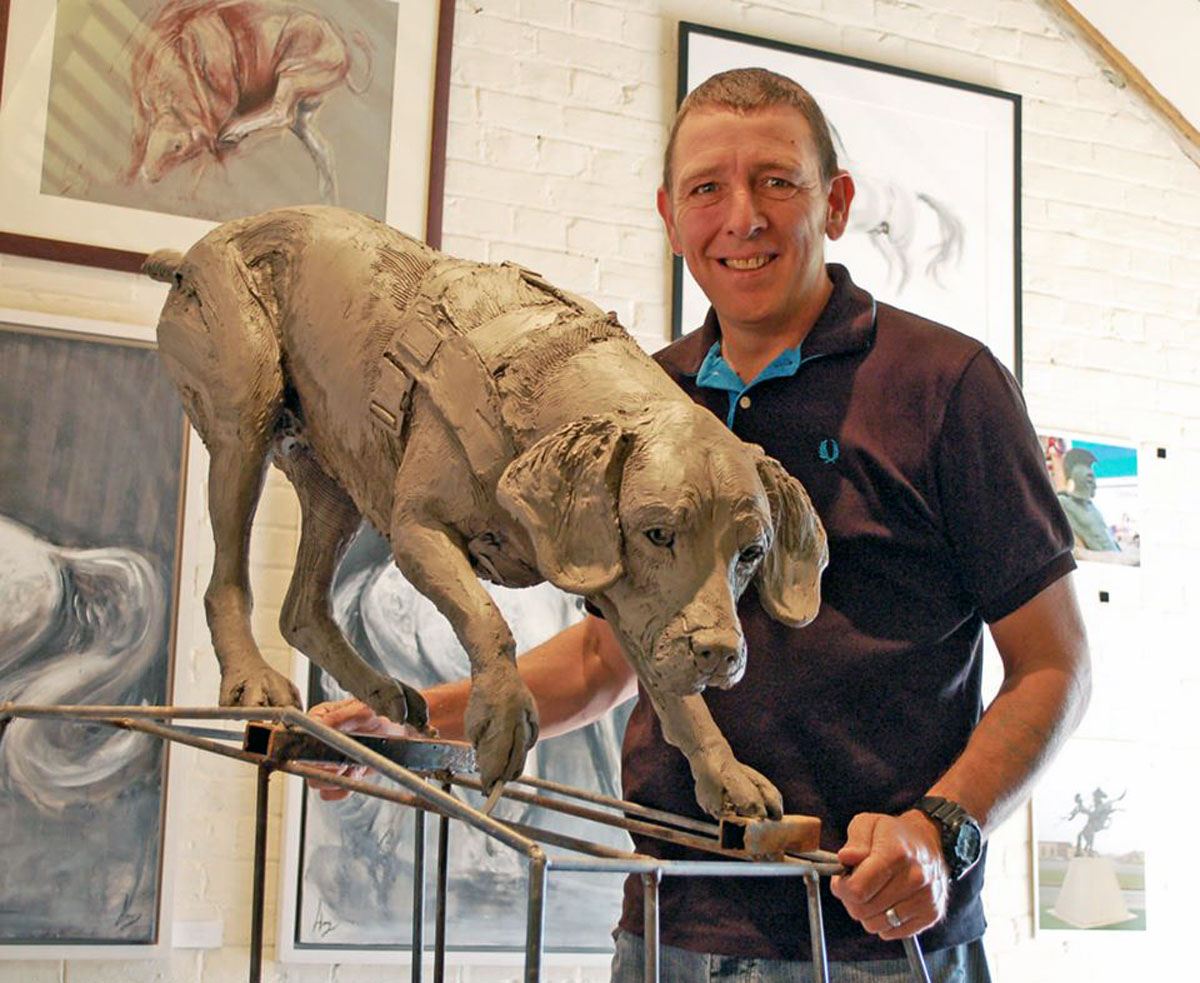 Dave Heyhoe, Treo's handler, with Treo in clay at Amy's studio